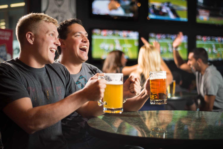 Two men enjoying Bully's Sports Bar & Grill